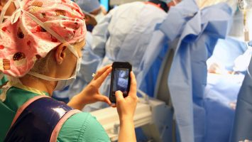 A nurse takes a photo during a recent surgery on an 8 year old boy at Arnold Palmer Hospital for Children in Orlando, Florida.  Doctors there have developed an app that allows nurses to safely and securely send texts, photos and videos from the OR directly to the smartphones of family members in an effort to keep them informed on progress during surgical procedures.  See how the app works here: bit.ly/1x820XI