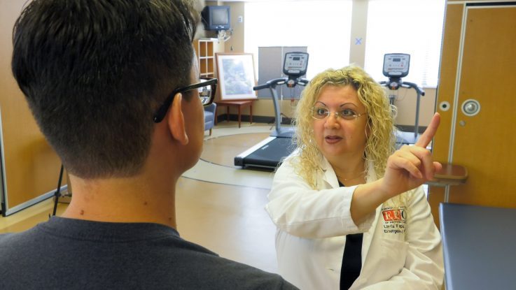 Linda Papa, MD, performs cognitive testing on a patient. She led a study at Orlando Health that found that college football players who had issues with things like memory and balance also had elevated biomarkers in their blood that indicate evidence of brain injuries.